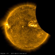Solar eclipse: The moon transits across the Sun in this picture from Nasa's Solar Dynamics Observatory satellite.