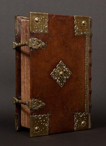 Dutch New Testament printed circa 1660 in Leyden by Paulus Aertsz van Ravesteyn in an early and ornate leather and brass binding.