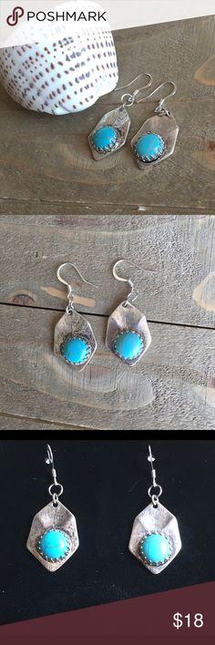 Turquoise and Silver Earrings Handmade Turquoise and silver earrings. Features silver plate ear wires. Handmade Jewelry Earrings