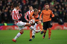 Wolverhampton Wanderers' George Saville (right) and Stoke City's Ibrahim Afellay battle for the ball
