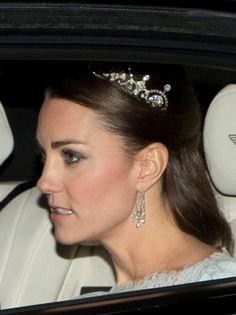 The Duke and Duchess of Cambridge on their way to a White-Tie Diplomats' Reception December 3, 2013. The Duchess wore Bespoke Cream Lace dress by Designer Alexander McQueen and the Papyrus/Lotus Tiara.