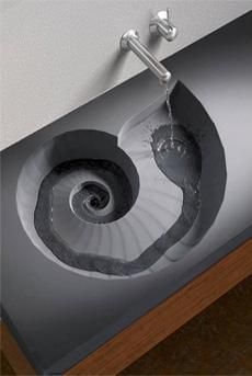 Awesome ammonite shaped vessel sink.