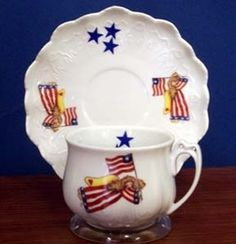 Our American Angel Cup and Saucer is made of porcelain and is perfect for any patriotic occasion.  The set includes 2 cups and 2 saucers and features scalloped edges on the saucer.