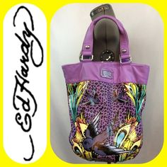 """Ed Hardy Purple & multi color Tote Bag """"Tania"""" ED HARDY STUDDED LEOPARD SPARROW TATTOO TANIA TOTE PURSE XL LARGEPurple and multi color Tote Bag """"Tania"""" with 3 pockets inside, one zipped and the trademark yellow Ed Hardy lining. Magnetic snap closure. This bag has some wear on the inside and a couple of places on the outside. Price reflects this. The bag measures 16 x 17 x 6 and overall Good condition. Ed Hardy Bags Totes"""