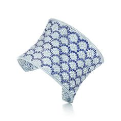 Tiffany & Co. -  Sapphire Scallop Cuff: A wide cuff of round blue sapphires and diamonds in 18k white gold. Carat total weight: round sapphires, 26.80; round brilliant diamonds, 24.30.
