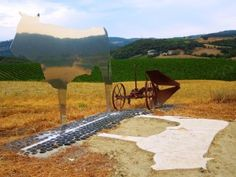 Val d'Orcia magic in the land art of Marco Pignattai dedicated to Montalcino, the invisible cow!