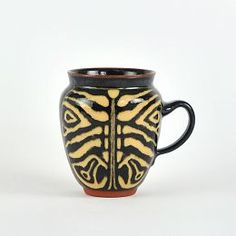 Bettle mug of earthenware by Danish ceramic artist Inge-Marie Fruelund. Inspired by cerambycidae beetle to be exact. Excellent.