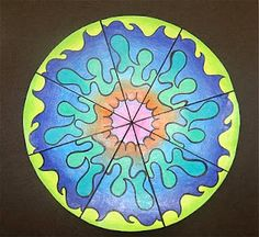 rotational symmetry - draw design on separate 1/8 piece. Color pencil lead on back and use pattern to trace design on all 8 sections. Trace with sharpie and color.