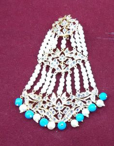 #Hyderabadi #Nizam #Jhoomar - This is a fan shaped bridal #hair #accessory introduced during the #Mughal era. Nizam #Jhoomars are made is pearls and #studded with #gemstones Choice of pearls like cream, off white, etc., semi precious stones like #emerald, #turquoise, etc. and many styles available. For custom orders please contact 408-800-7134