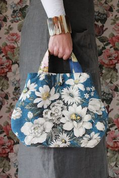 Meet Lulu...she is a rather pretty handbag made from a rare vintage Sanderson floral print. She likes to be taken out for tea and she likes to think she is not only a bag but a rather pretty accessory to your daily wear. When not in use she likes to be hung on a wall so all can share in her beauty.She is approx 33cm wide.Lulu will arrive wrapped in tissue in her own personal box. This box is then wrapped in Kraft Paper to protect it on its journey so that it can be kept o...