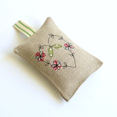 Handmade delicately embroidered natural linen lavender bag with heart and flowers © Stitch Galore