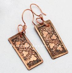 "Etched #Copper #Pawprint #Earrings with #Handmade #Heart Connection #Earring Hooks by #ButterflySundries  Does your #pet walk all over you? Do you feel like you have #paw prints claiming you as your pet's very own? If so, you might appreciate this one-of-a-kind etched earring set, complete with a handmade wire copper heart connections!    This is one of my original ""Fur Babies"" designs I've created for my March-May 2013 Featured Charity: Spokane Humane Society (they get 10% of the sale…"
