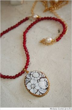 Vermeil necklace with authentic shell cameo with flowers - handcarved on Sardonyx shell from Torre del Greco - silver 925 plated with 18 K gold from Pisa, Italy-based Etsy shop MelaniaGorinJewelry