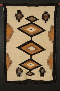 NAVAJO RUG WITH DIAMONDS AND SERRATED DESIGNS