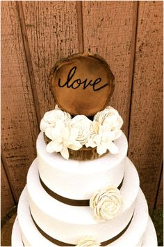 """Cute and Chic Rustic Wedding Cake Toppers. Would love to put our  first names or a """"C""""on the wood instead of the """"love"""""""