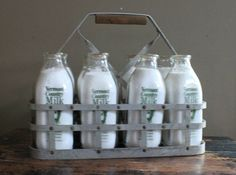 Milk delivered to our country school, often frozen by the time school started and still slushy for lunch. Old Milk Bottles, Vintage Milk Bottles, Antique Bottles, Milk Bottle Holder, Milk Cafe, Milk The Cow, Monopole, Milk Packaging, Churning Butter