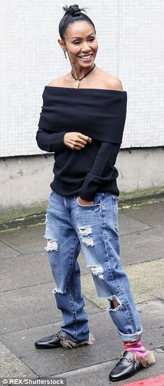 Fancy footwear: Outside the central London studios, the star wore a pair of casual ripped denim jeans and designer kangaroo-fur Gucci slippers on her feet