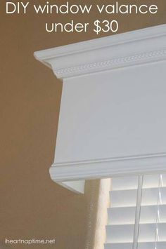 Valance that looks like the window trim. I like this (plus more allergy friendly than fabric).