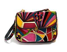 Classic and rare vintage 1960s Emilio Pucci handbag. Colorful psychedelic print on soft cotton velvet. Black leather piping around edges.