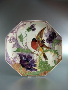 """Plate 1913, the Rozenburg Dutch Porcelain Company (1883-1914). The company was the first to create dishes in the Art Nouveau style. At the Paris World Exhibition in 1900, Rozenburg porcelain caused a sensation. Visitors to exhibition were impressed by the innovative design & quality of the tableware made in a thin translucent porcelain called """"Eggshell"""". The product was such a success that it immediately sold out. This delicate creamy-white porcelain portrays paintings with animal & plant…"""