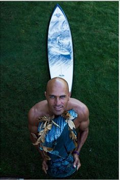 Kelly Slater Pipe Mastes champion, trophy board & bronze trophy of Gerry Lopez by Phil Roberts