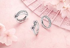Silver rings from pandora. The theme for the new stuff is spring cherry blossoms, so there are some pretty cool flower shapes you can stack and combine with other rings. http://www.pandora.net/en-au/explore/campaigns/spring-styleguide