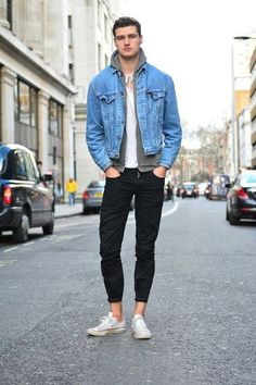 Opt for a light blue denim jacket and black skinny jeans for a comfortable outfit that's also put together nicely. If you don't want to go all out formal, grab a pair of white canvas low top sneakers.   Shop this look on Lookastic: https://lookastic.com/men/looks/denim-jacket-hoodie-crew-neck-t-shirt/17639   — Grey Hoodie  — White Crew-neck T-shirt  — Light Blue Denim Jacket  — Black Skinny Jeans  — White Canvas Low Top Sneakers