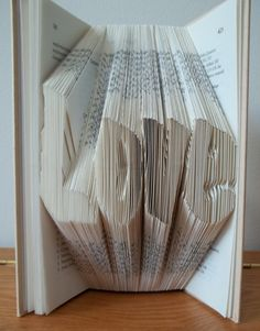 The word Love folded from a old book.    The books I use are salvaged from old book stores. I select them all by hand to make sure they are up to my #craftshout0211