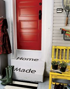 Playful stenciling on the steps of this garage creates a welcoming entrance. #decorating