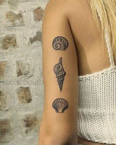 Seashells tattoo by Lucas Lua de Souza. Shell tattoos are very special and romantic. They evoke feelings of peace and tranquillity, they remind us of the beating sounds of the waves. Enjoy!