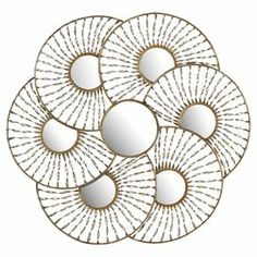 """Metal wall decor with 7 round mirrors encircled in twist accents.  Product: Wall decorConstruction Material: Metal and mirrored glassColor: Antiqued gold and silver frame Features: Seven mirroredDimensions: 38.25"""" H x 41"""" W"""