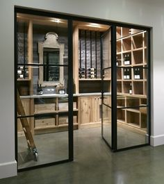 rustic wood finishes in this otherwise modern wine cellar - design by Barbara Colvin