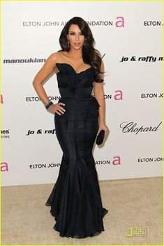 2011 - Kim Kardashian in  J. Mendel gown with Lorraine Schwartz jewels, Christian Louboutin heels, and a Judith Leiber clutch.