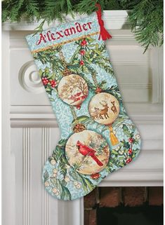 """Gold Collection Enchanted Ornament Christmas Stocking $29.03 at 123Stitch.com. Counted cross stitch kit contains presorted cotton thread, metallic thread, wool yarn, 16 count blue cotton Aida, polyester felt, needle, and easy instructions with an alphabet. Finished Size: 16"""" long"""