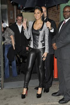 Nicole Scherzinger donned a sleek pair of black leather leggings with a matching jacket.