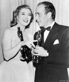 Greer Garson (standing in for Vivien Leigh, winner for A Streetcar Named Desire) and Humphrey Bogart (winner for The African Queen). March, 1952