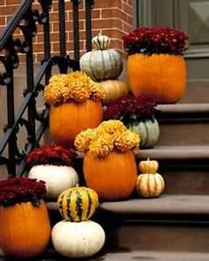 pumpkins to line stairs in main entrance - groups of three with mums