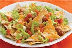 Transform flour tortillas into crispy, crunchy tortilla chips in this simple nacho recipe. Topped with all of your favourite fixings, these Cheesy Tortilla Nachos are quick, easy and tasty! Nacho Recipes, Mexican Food Recipes, Vegetarian Recipes, Cooking Recipes, Healthy Recipes, Ethnic Recipes, Mexican Meals, What's Cooking, Kraft Recipes