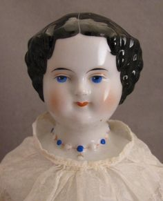 German Alt Beck & Gottschalck china shoulder head doll with molded necklace