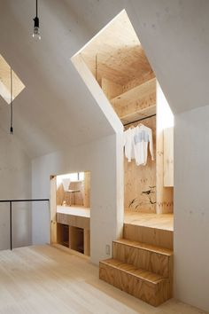 Larch plywood clads personal spaces which wrap around a central living area in a Japanese home by MA-style Architects. - Architecture and Home Decor - Bedroom - Bathroom - Kitchen And Living Room Interior Design Decorating Ideas - Deco Design, Design Case, Design Design, Attic Spaces, Small Spaces, Hidden Spaces, Attic Rooms, Interior Exterior, Interior Architecture