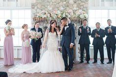 Bride and groom at wedding ceremony at elegant glam wedding at Mallard Island Yacht Club.