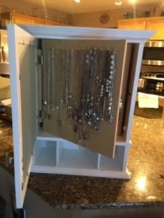 My daughter has a huge collection of necklaces. Weve tried various ways of organizing them and then came up with this customized jewelry cupboard which stores 50 necklaces. Jewelry Box, Jewelry Making, Organizing, Organization, Cupboard, Fun Crafts, Custom Made, Liquor Cabinet, Craft Projects