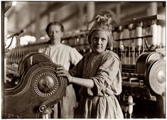 "November 1908. ""A typical Spinner"" at Lancaster Cotton Mills in South Carolina. Photograph and caption by Lewis Wickes Hine. Note from granddaughter of girl: ""This is a photo of my great grandmother Sarah (Sadie) Agnes Lenore Barton Howard. She was identified after the photo was published in the Lancaster News last December. She was 13 when this photo was taken and eventually married my great-grandfather, who also worked in the cotton mill. Thought you might find it interesting""!"