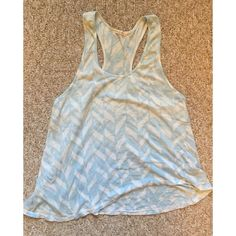 Alternative Apparel Racer Back Asymmetrical Tank Pre-loved Alternative Apparel asymmetrical racer back tank. It has a blue and white print. In good condition! Alternative Apparel Tops Tank Tops