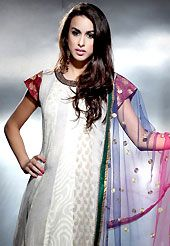 Embroidered suits are the best choice for a girl to enhance her feminine look. The dazzling off white chanderi silk readymade churidar suit have amazing embroidery patch work is done with zari, sequins, and lace work. Beautiful embroidery work on kameez is stunning. The entire ensemble makes an excellent wear. Contrasting dark green santoon churidar and shaded net dupatta is available with this suit. Slight Color variations are possible due to differing screen and photograph resolutions.