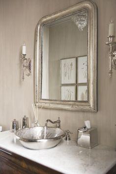 looks like Quatrine Furniture's Venetian Mirror in silver leaf finish. So pretty!