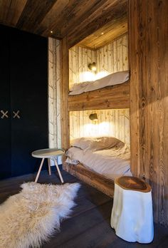 An elegant chalet in the French ski village of Megeve with a very remarkable and original design by studio Refuge .