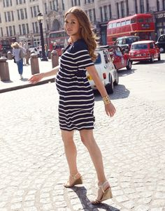 Work a chic nautical look this season with our Woven Maternity Dress. Made in lightweight woven viscose; this striped maternity dress is expertly tailored to fit and flatter your curves throughout pregnancy & beyond. Chic eyelet detailing accents the stylish v neckline, while a self-tie belt at the empire waist works to define your shape and highlight your slimmest point. Pair this dress with sandals for a look that will take your seamlessly from day to night.