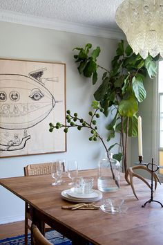 Love the feel of this dinning room... the cool, crisp glass, the warm wood, the breathing plants. Wonderful