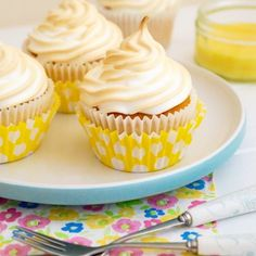 Lemon cupcakes filled with tangy lemon curd, and topped with fluffy meringue!